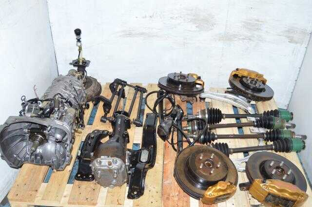 JDM V7 WRX STi 6 Speed TY856WB1AA Transmission with R180 Diff, Axles, Driveshaft, Control Arms & Brembos 5x100 6MT Non-DCCD