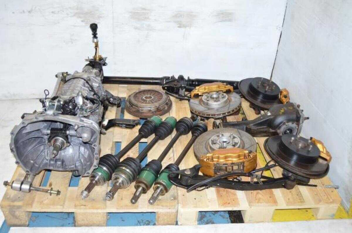 used JDM Subaru STi TY856WB3KA 6MT Six Speed DCCD Transmission Package Axles, Brembo Calipers, 5x100 Hubs, R180 Differential , Lateral Links, Drive Shaft, Subframes, Sway Bar