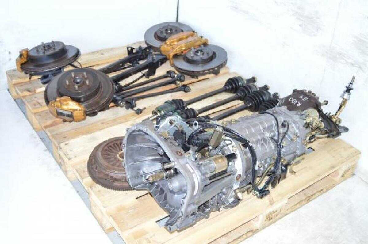 Used JDM Subaru STi TY856WB3KA 6 Speed DCCD Transmission Package with 4 Corner Axles, Brembo Calipers , 5x100 Hubs, Control Arms, etc