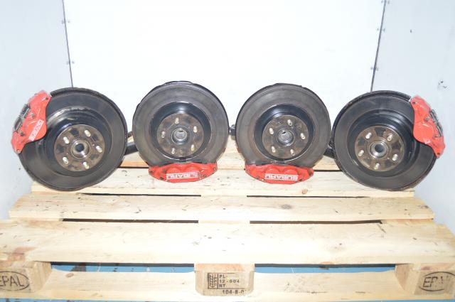 JDM Red Subaru 4 Pot 2 Pot Brakes with Hubs, Trailing Arms, Rotors and Pads from a 2006-2007 WRX