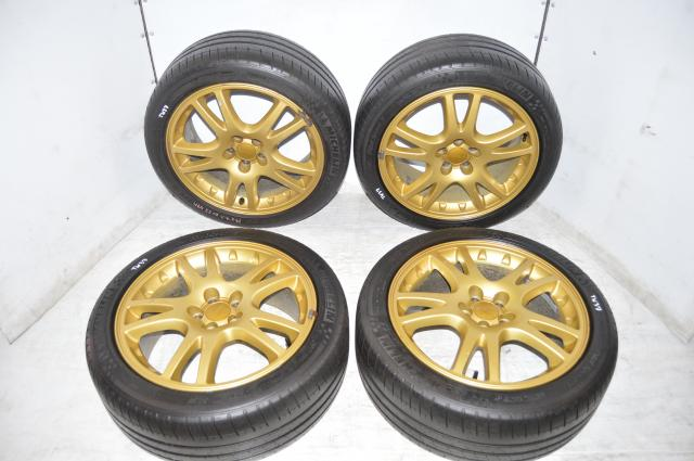 Subaru V7 JDM STI Gold 5x100 Wheels with 225/45/17 Michelin Pilot Sport Tires for sale for 2002-2007 Models