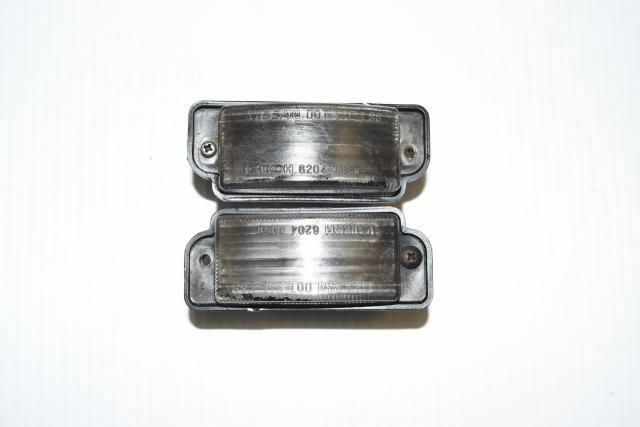 Used JDM Nissan Skyline R32 GTR Rear Bumper License Plate Lights for Sale - Smoke